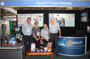 Aqualift employees in a booth at a show
